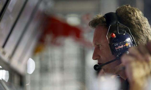 Red Bull Formula One team principal Horner looks at a screen on the pit wall during the qualifying session of the Singapore Formula One Grand Prix