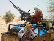 Islamist rebels of Ansar Dine are pictured in April 2012 near Timbuktu. The March 22 coup in Mali allowed Tuareg rebels and Islamists to make large gains in the country's desert north
