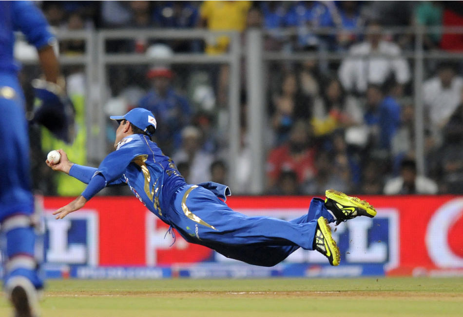 Ricky Ponting captain of Mumbai Indians dives to complete a catch to get Unmukt Chand of Delhi Daredevils out during match 10 of the Pepsi Indian Premier League ( IPL) 2013  between The Mumbai Indians