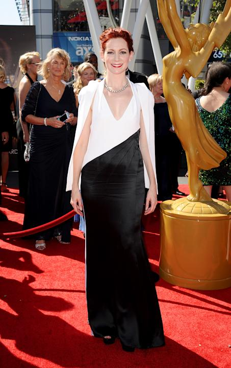 Carrie Preston arrives at the 2013 Primetime Creative Arts Emmy Awards, on Sunday, September 15, 2013 at Nokia Theatre L.A. Live, in Los Angeles, Calif. (Photo by Scott Kirkland/Invision for Academy o