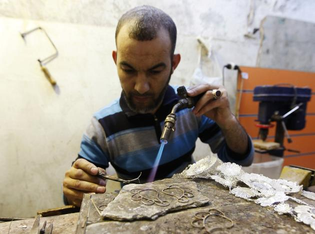 Osama, a silversmith, works in his father's workshop in Tripoli