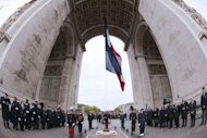 French soldiers parade during a ceremony marking the 67th anniversary of the Allied victory over Nazi Germany in World War II, in Paris. Pressure built on president-elect Francois Hollande to stand by France's austerity vows Tuesday, with Germany's Angela Merkel saying Europe was counting on them to resolve the bloc's debt crisis