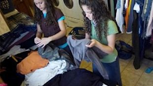 The Duggars tackling laundry.