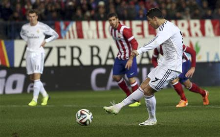 Real Madrid's Ronaldo scores a penalty against Atletico Madrid during their Spanish King's Cup semi-final second leg match in Madrid