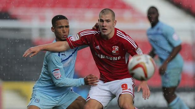 James Collins, right, scored the winner to keep Swindon's promotion bid on track