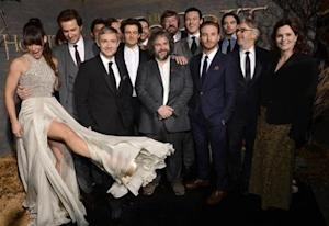 "Cast and crew members pose at the premiere of the film ""The Hobbit: The Desolation of Smaug"" in Los Angeles"