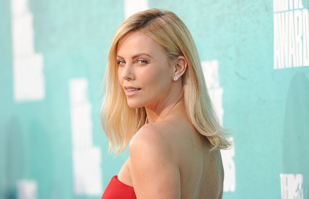 OMG. Charlize Theron Shaves Off Her Luscious Blonde Hair!