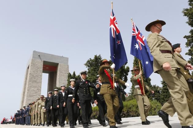 ANZAC soldiers parade past the Turkish memorial during an international service in Gallipoli