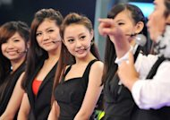 "Chinese native Qi Ji (C) and her Taiwanese teammates answer questions after performing during a new talent show ""Asian Idol Group Competition,"" in Taipei, in May. Growing numbers of young Chinese performers are eschewing the entertainment scene at home and instead coming to Taiwan in the hope of getting a big break"
