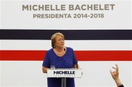 Chile's President-elect Michelle Bachelet listens to a question during a news conference at her headquarters in Santiago, December 16, 2013. REUTERS/Ivan Alvarado