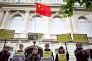 Amnesty International activists take part in a protest in support of blind Chinese activist Chen Guangcheng, on May 9, 2012 in front of the China's embassy in Paris