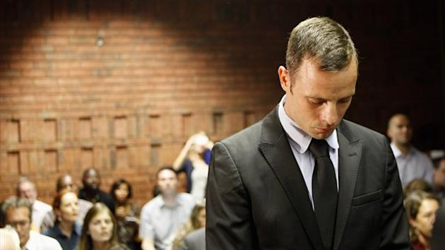 Oscar Pistorius stands in the dock during a break in court proceedings at the Pretoria Magistrates court (Reuters)