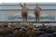 "North Korean soliders and officials pay their respects in front of statues of the nation's former leaders in Pyongyang A Japanese government minister has come under fire from the opposition for saying North Korea should ""waste no time"" in holding its planned rocket launch so he can campaign in earnest for the upcoming election"