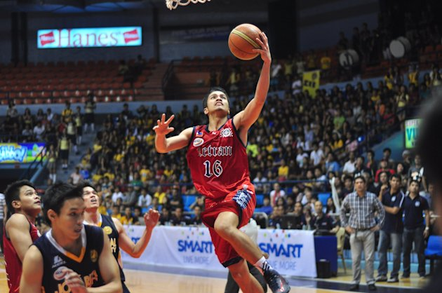 Letran's Kevin Racal soars in for a lay-up. (NPPA Images)