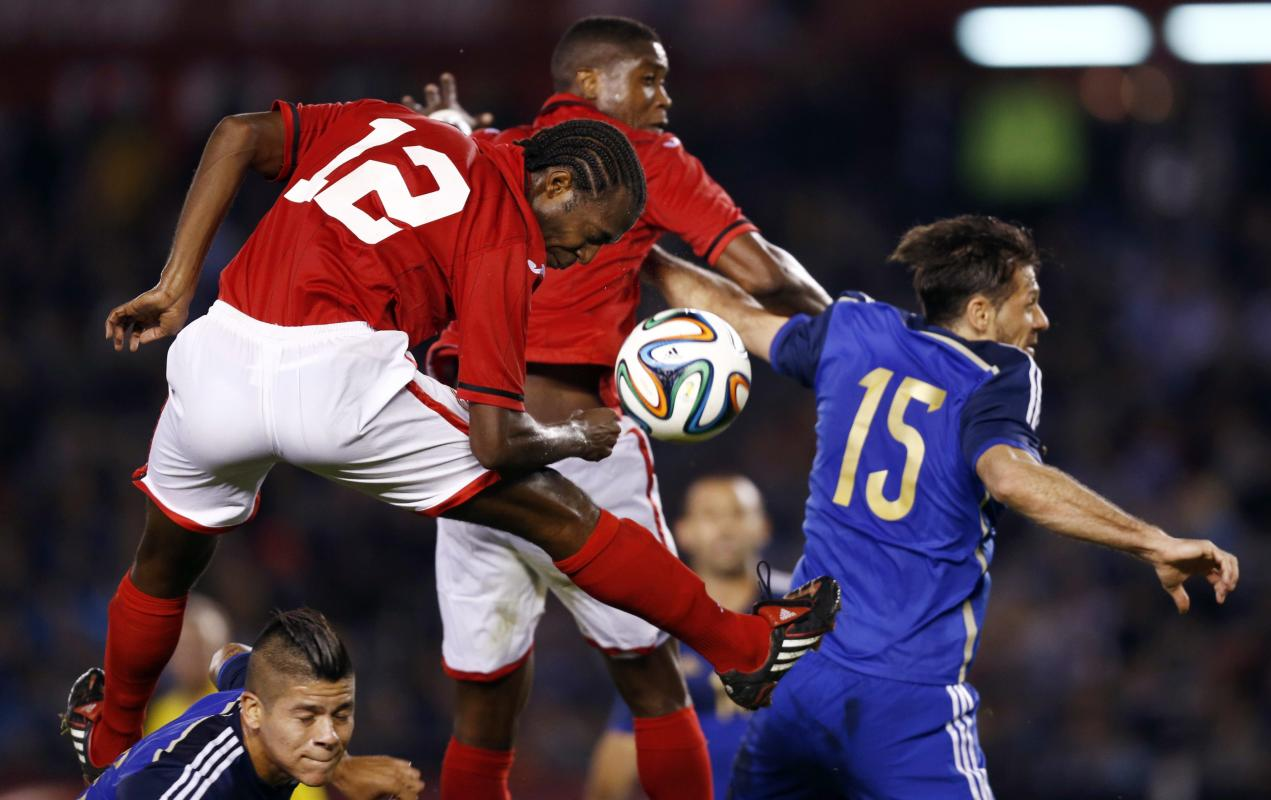 Trinindad and Tobago's Marshall heads the ball against Argentina during their friendly soccer match in Buenos Aires