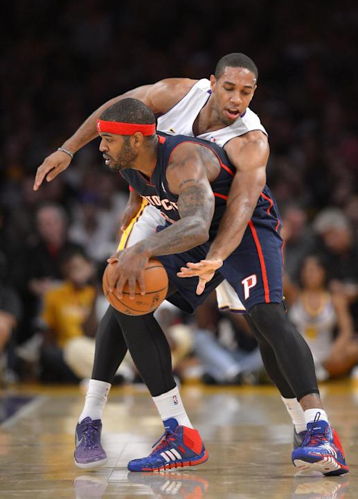 Los Angeles Lakers forward Xavier Henry, top, reaches in on Detroit Pistons forward Josh Smith during the first half of an NBA basketball game Sunday, Nov. 17, 2013, in Los Angeles
