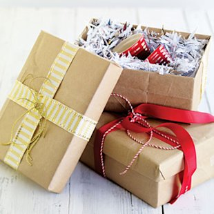 Paper bags, fabric remnants, and magazine pages become gift wrap