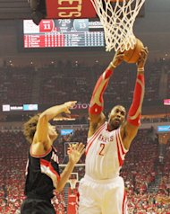 HOUSTON, TX - APRIL 23: Dwight Howard #12 of the Houston Rockets drives with the ball against Robin Lopez #42 of the Portland Trail Blazers during the first half in Game Two of the Western Conference Quarterfinals during the 2014 NBA Playoffs at Toyota Center on April 23, 2014 in Houston, Texas. NOTE TO USER: User expressly acknowledges and agrees that, by downloading and or using this photograph, User is consenting to the terms and conditions of the Getty Images License Agreement. (Photo by Scott Halleran/Getty Images)