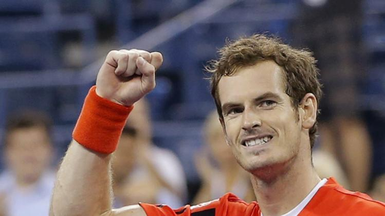 Andy Murray of Britain celebrates defeating Denis Istomin of Uzbekistan at the U.S. Open tennis championships in New York