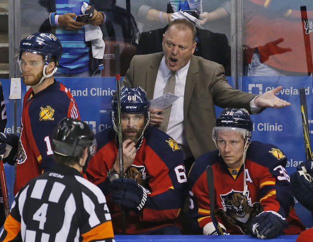 Florida Panthers head coach Gerard Gallant argues a call with referee Wes McCauley (4) during the third period of Game 2 in a first-round NHL hockey Stanley Cup playoff series against the New York Islanders, Friday, April 15, 2016, in Sunrise, Fla. (AP Photo/Wilfredo Lee)