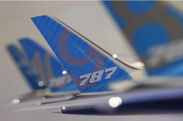 Tailwing of a model Boeing 787 Dreamliner aircraft is pictured at the Boeing booth at the Singapore Airshow