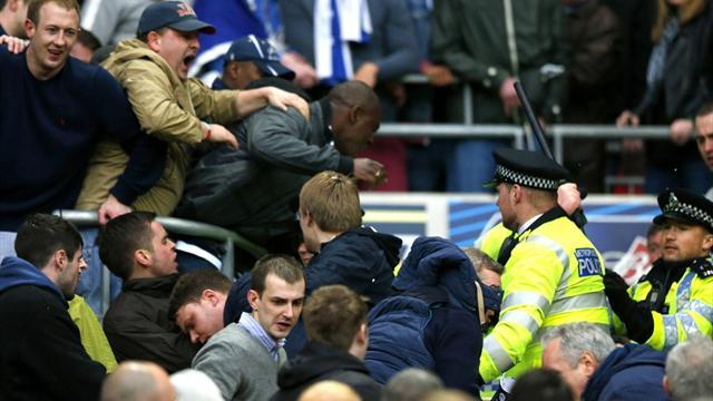 FA Cup - Millwall fans fight themselves in the stands during semi-final