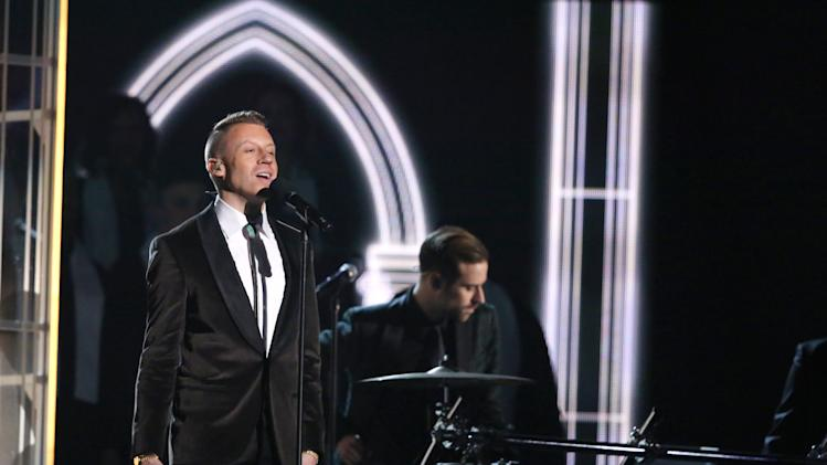 "Macklemore performs ""Same Love"" on stage at the 56th annual Grammy Awards at Staples Center on Sunday, Jan. 26, 2014, in Los Angeles. (Photo by Matt Sayles/Invision/AP)"