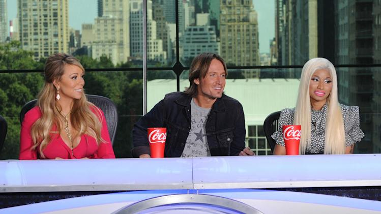 "FILE - This Sept. 17, 2012 file image released by Fox shows the new judges for the singing competition series, ""American Idol,"" from left, Mariah Carey, Keith Urban and Nicki Minaj and during a news conference in New York.  (AP Photo/FOX, Michael Becker)"