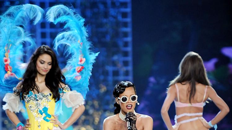 Singer Rihanna, center, performs while models walk the runway during the 2012 Victoria's Secret Fashion Show on Wednesday Nov. 7, 2012 in New York. The show will be Broadcast on Tuesday, Dec. 4 (10:00 PM, ET/PT) on CBS. (Photo by Evan Agostini/Invision/AP)