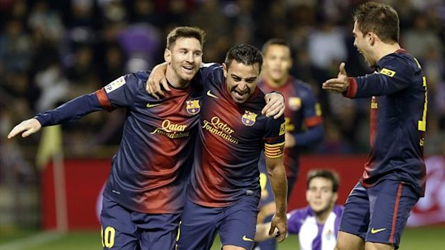 Barcelona pair Lionel Messi and Xavi celebrate during the Liga win at Real Valladolid on December 22