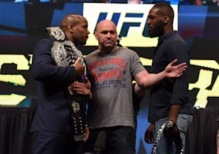 UFC president holds Daniel Cormier and Jon Jones back from one another during a media event. (Getty)