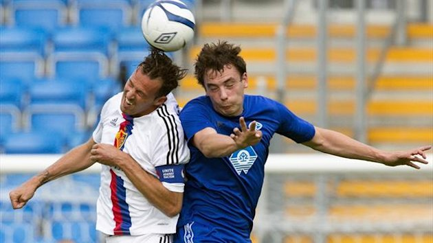 Vegard Forren (R) of Norway's Molde and Marco Streller of Switzerland's Basel fight for the ball