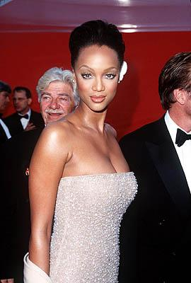 Seymour Cassel looks over the shoulder of Tyra Banks 70th Annual Academy Awards Los Angeles, CA 3/23/1998