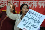 Indian women shout slogans during a protest following the gang-rape of a student in New Delhi on December 18, 2012. New Delhi's police chief has demanded the death penalty for rapists amid growing outrage over the gang-rape of a 23-year-old student on a school bus in the city