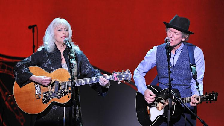 "Musicians Emmy Lou Harris, left, and Rodney Crowell perform at ""Play It Forward: A Celebration of Music's Evolution and Influencers"" at the Grammy Foundation's 15th Annual Music Preservation Project, Thursday, Feb. 7, 2013, in Los Angeles. (Photo by Vince Bucci/Invision/AP)"