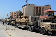 Egyptian miltary trcuks loaded with light tanks line up in el-Arish ahead of an operation to restore security in northern Sinai, on August 9. Gunfire broke out in the Sinai town of El-Arish, reports said, as tensions simmered after the Egyptian authorities vowed to crush a surge in Islamist militancy in the tense peninsula