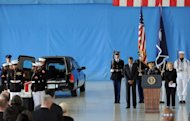 US President Barack Obama and Secretary of State Hillary Clinton bow during a ceremony marking the return of the remains of four Americans killed in Benghazi, Libya, at Andrews Air Force Base in Maryland, September 14. Obama has carved out a clear advantage in the White House race even as he juggles the demands of his re-election campaign with managing a raging Middle East crisis