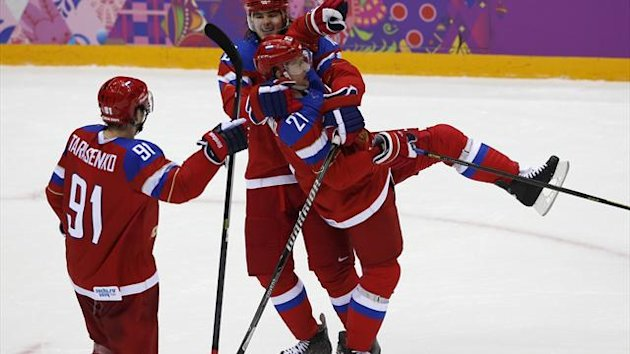 Russia's Alexei Tereshenko (27) celebrates his goal against Norway with teammates Viktor Tikhonov and Vladimir Tarasenko during the third period