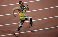 "Oscar ""Blade Runner"" Pistorius in action at the Paralympics in London on August 5, 2012. South African police said Thursday they have charged Olympic sprint star Pistorius with the Valentine's Day murder of his model girlfriend, playing down reports she was mistaken for a burglar"