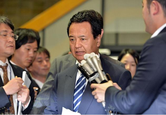 Akira Amari, Japanese State Minister in charge of Trans-Pacific Partnership (TPP) speaks to reporters after he met with US trade representative Michael Froman at Amari's office in Tokyo on April 1