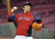 Oct 22, 2013; Boston, MA, USA; Boston Red Sox relief pitcher Koji Uehara (19) throws a pitch during workouts the day before game one of the 2013 World Series against the St. Louis Cardinals at Fenway Park. Mandatory Credit: Bob DeChiara-USA TODAY Sports