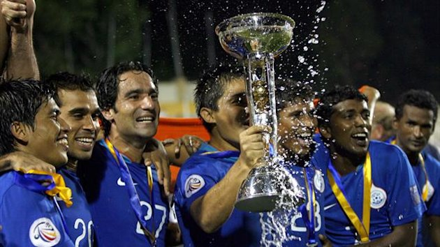 India's players celebrate with their trophy after winning against Tajikistan during the AFC Challenge Cup soccer final match in New Delhi (Reuters)