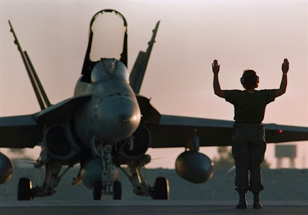 A Canadian CF-18 gets the go-ahead for takeoff at dusk at the military base in Dohar, Qatar on December 3, 1990. THE CANADIAN PRESS/Paul Chiasson