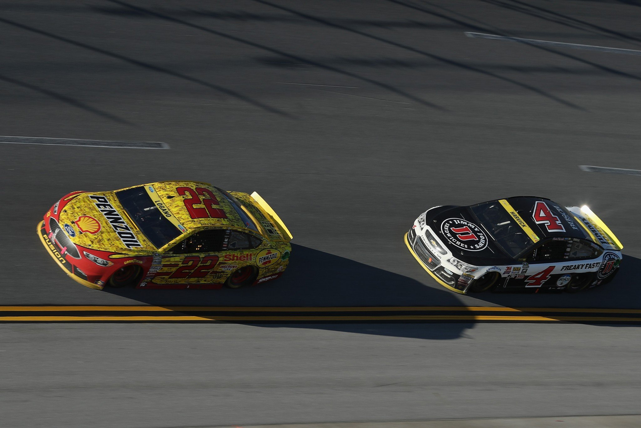 Kevin Harvick trails Joey Logano in this picture, but he leads him in Power Rankings. (Getty)