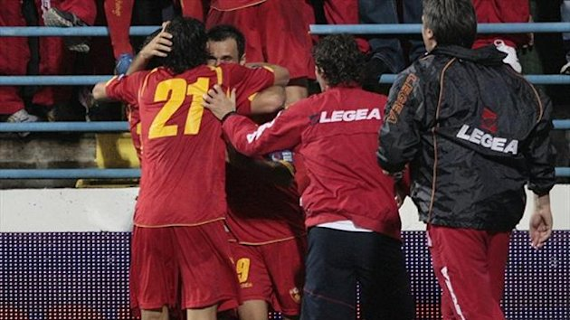 Montenegro's players celebrate (Reuters)