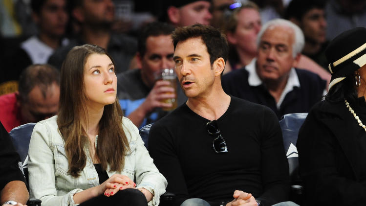 Actor Dylan McDermott and daughter Colette Rose McDermott attend an NBA basketball game bettween the Phoenix Suns and the Los Angeles Lakers, Sunday, March 30, 2014, in Los Angeles.(AP Photo/Gus Ruelas)