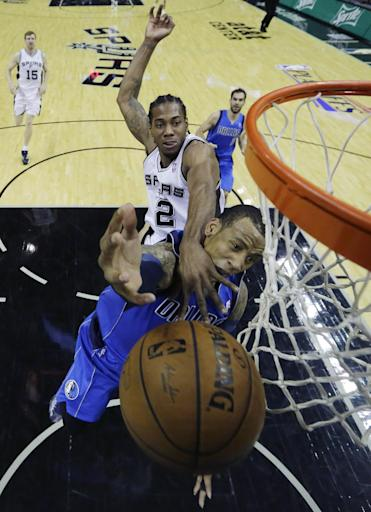 Duncan scores 27 points, Spurs beat Mavs 90-85
