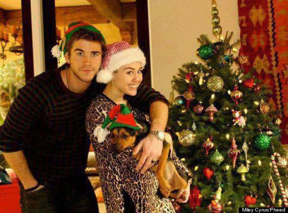 Celebs in Santa Hats: Miley Cyrus and her fiancee Liam Hemsworth get into the festive spirit. Copyright: [Instagram]