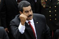 Venezuelan President Nicolas Maduro clenches his fist as he enters to the National Assembly before the Presidential inauguration in Caracas on April 19, 2013. Maduro was sworn in as president of Venezuela on Friday, taking the oath of office in the memory of the late Hugo Chavez to cheers in the National Assembly