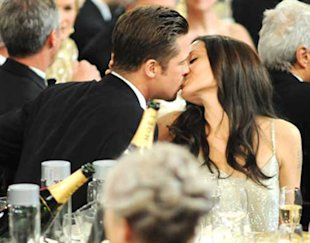 Brad Pitt and Angelina Jolie kissing